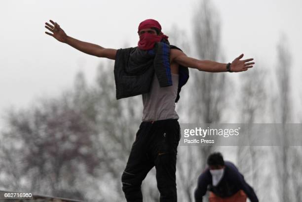 Youth clash with Indian police men in the outskirts of Srinagar in Indian Controlled Kashmir on Mar 31 2017 The protests and clashes were erupted...