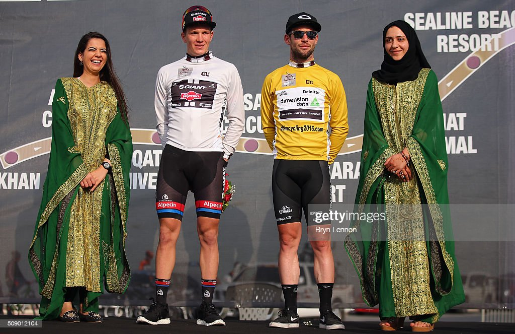 Youth Classification leader Søren Kragh Andersen of Denmark and Team Giant-Alpecin stands beside stage winner <a gi-track='captionPersonalityLinkClicked' href=/galleries/search?phrase=Mark+Cavendish&family=editorial&specificpeople=684957 ng-click='$event.stopPropagation()'>Mark Cavendish</a> of Great Britain and Dimension Data after stage one of the 2016 Tour of Qatar, a 176.5km road stage from Durkhan to Al Khor Corniche on February 8, 2016 in Al Khor Corniche, Qatar.
