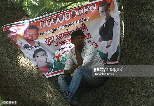 Youth Congress workers hold banners and posters during Jan Akrosh Rally to protest against the alleged failure of the Narendra Modi government at...