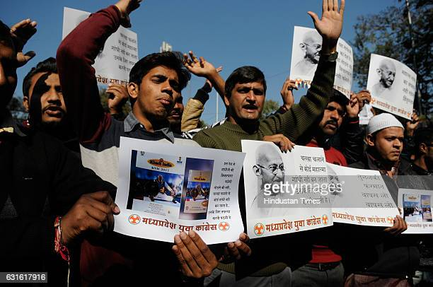 Youth Congress workers staging a demonstration to protest against an iconic shot of Mahatma Gandhi replaced by Prime Minister Narendra Modi on 2017...