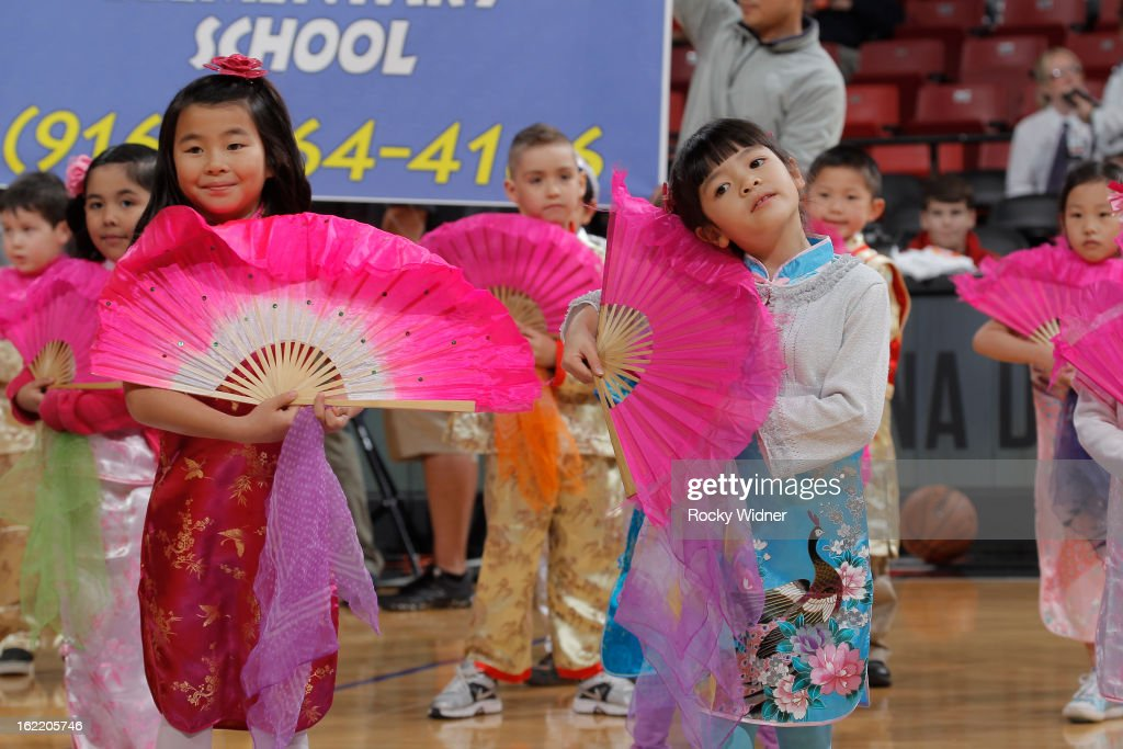 Youth dancers perform for the Chinese New Years celebration during the game between the Houston Rockets and the Sacramento Kings on February 10, 2013 at Sleep Train Arena in Sacramento, California.