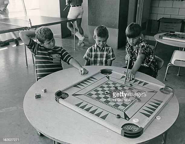 JUL 16 1970 JUL 24 1971 JUL 28 1971 Youth Eyes Next Shot Tony Dick Tommie Dick and Craig Hansen ***** in game on carom board The Aurora Parks and...