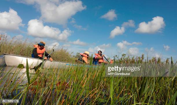 A youth group make their way during a canoe trial into the Everglades at the Arthur R Marshall Loxahatchee National Wildlife Refugee in Boynton Beach...