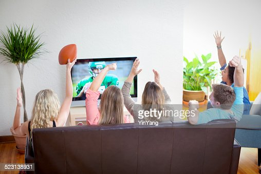 Youth Group Watching Sport Football Program on TV Together