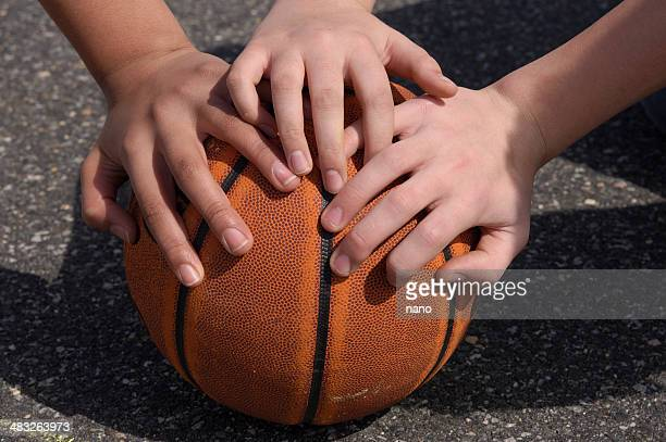 youth hands on basketball