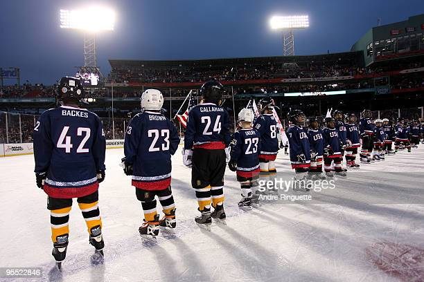 Youth hockey players are seen on the ice as the 2010 USA Men's Olympic Hockey team was announced after the Boston Bruins won 21 in overtime against...