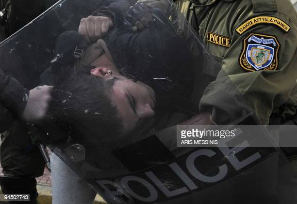A youth is detained by riot police during a demonstration in central Athens on December 7 2009 Riot police clashed with stonethrowing youths in...