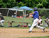 Little league baseball player batting