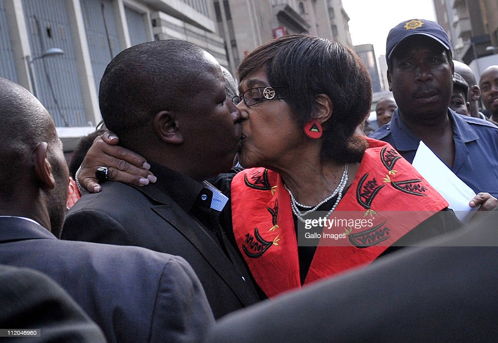 Youth League president <a gi-track='captionPersonalityLinkClicked' href=/galleries/search?phrase=Julius+Malema&family=editorial&specificpeople=5866727 ng-click='$event.stopPropagation()'>Julius Malema</a> is embraced by ANC stalwart Winnie Madikizela-Mandela outside the High Court on April 11, 2011 in Johannesburg, South Africa. Malema appeared on charges of inciting hatred for singing the song 'Shoot The Boer', laid against him by Tshwane-based lobby group AfriForum.