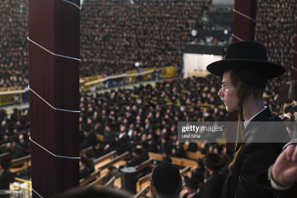 A youth looks on as tens of thousands of Ultra-Orthodox Jews of the Belz Hasidic Dynasty take part in the wedding ceremony of Rabbi Shalom Rokach, the Grandson of the Belz Rabbi to Hana Batya Pener, early morrning of May 22, 2013. in Jerusalem, Israel. Some 25,000 Ultra-Orthodox Jews participated in one of the biggest weddings of the of Ultra-Orthodox Jewish community in the past few years.