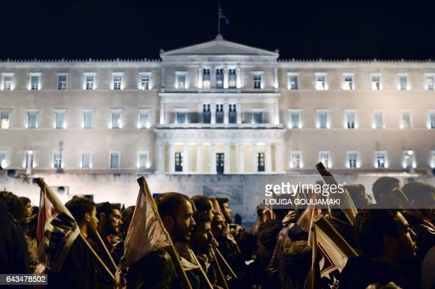 TOPSHOT Youth marches in front of the Greek parliament during an antiausterity rally in central Athens called by the communistaffiliated workers...