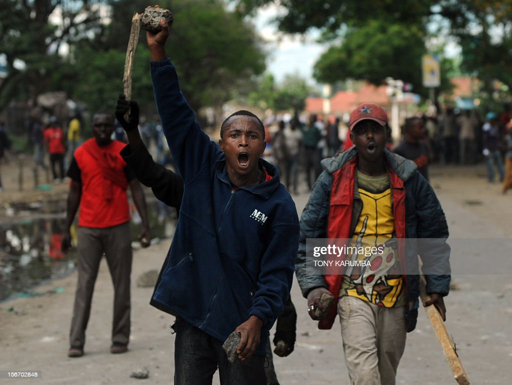 Youth of non-Somali ethinicity armed with stones and crude weapons retaliate on November 19, 2012 during inter-ethnic clashes in Nairobi's Eastleigh suburb. Clashes broke out a day after a bomb exploded in a minibus, blamed on sympathisers of Somalia's Al-Qaeda-linked Shebab insurgents, killing seven people and leaving several wounded. A day after the blast, non-Somali Kenyans turned on Somalis and attacked their shops and stalls, accusing them of being responsible for the bomb. No one has claimed responsibility for the blast. AFP PHOTO / Tony KARUMBA