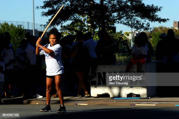 Youth participants attend the inaugural PLAY BALL Stickball event outside of Yankee Stadium on Saturday September 23 2017 in the Bronx borough of New...