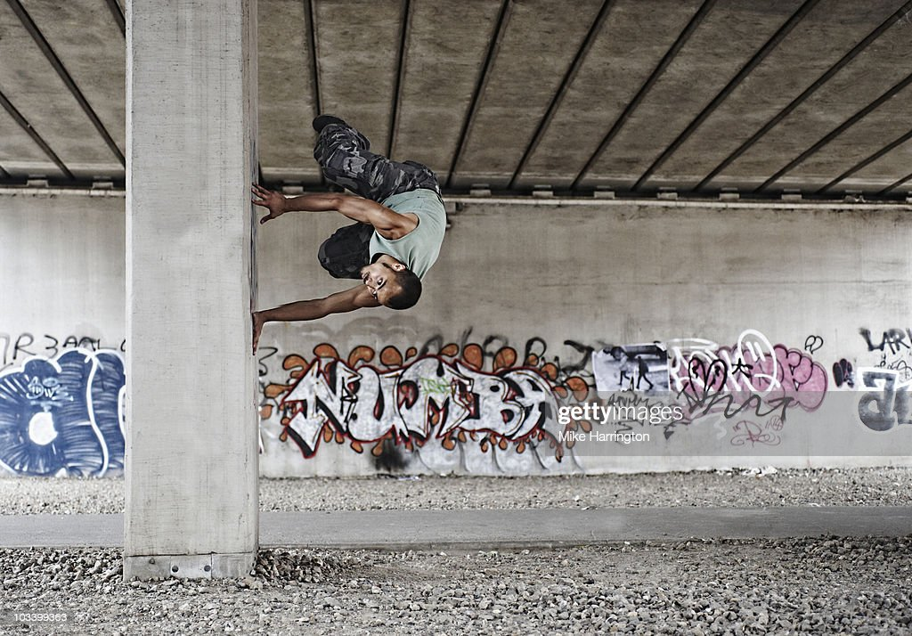Youth performing parkour : Stock Photo