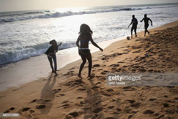 Youth play soccer on the beach on January 25 2015 in Monrovia Liberia With Ebola cases now in single digits nationwide many Liberians have begun to...