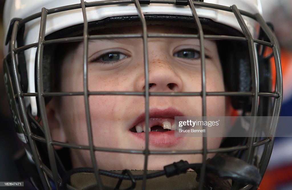 Youth player Jonathan Beale, age 7, waits to get on the ice during an appearance by Hockey Hall of Famer Wayne Gretzky at the Abe Stark Arena on February 25, 2013 in New York City. The event was organized by TD Bank who donated funds to the Greater New York City Ice Hockey League to replace equipment that was lost or destroyed during Superstorm Sandy.
