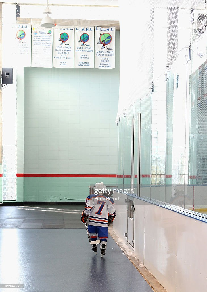 A youth player waits to get on the ice during an appearance by Hockey Hall of Famer Wayne Gretzky at the Abe Stark Arena on February 25, 2013 in New York City. The event was organized by TD Bank who donated funds to the Greater New York City Ice Hockey League to replace equipment that was lost or destroyed during Superstorm Sandy.