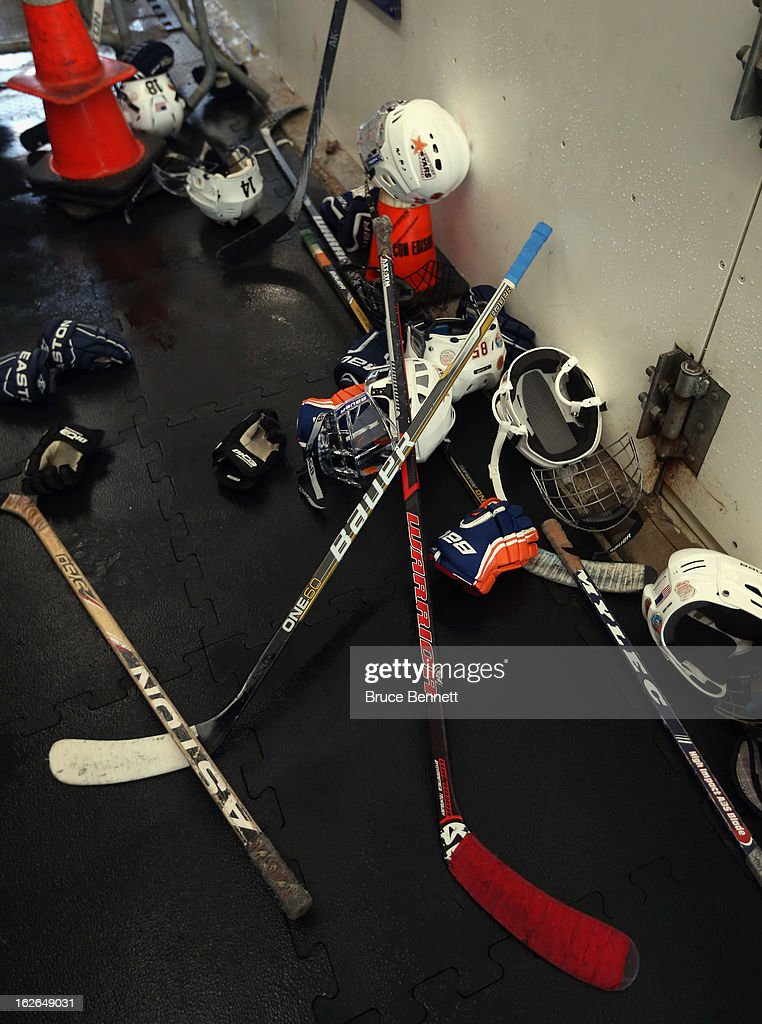 Youth players equipment sits by the hockey boards as Hockey Hall of Famer Wayne Gretzky makes an appearance at the Abe Stark Arena on February 25, 2013 in New York City. The event was organized by TD Bank who donated funds to the Greater New York City Ice Hockey League to replace equipment that was lost or destroyed during Superstorm Sandy.