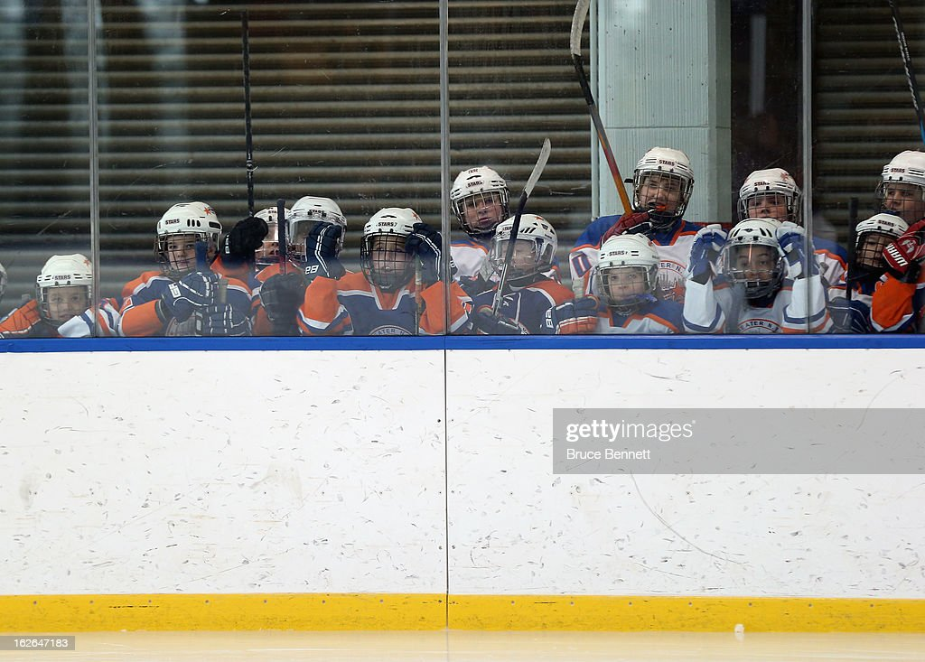 Youth players wait to get on the ice during an appearance by Hockey Hall of Famer Wayne Gretzky at the Abe Stark Arena on February 25, 2013 in New York City. The event was organized by TD Bank who donated funds to the Greater New York City Ice Hockey League to replace equipment that was lost or destroyed during Superstorm Sandy.
