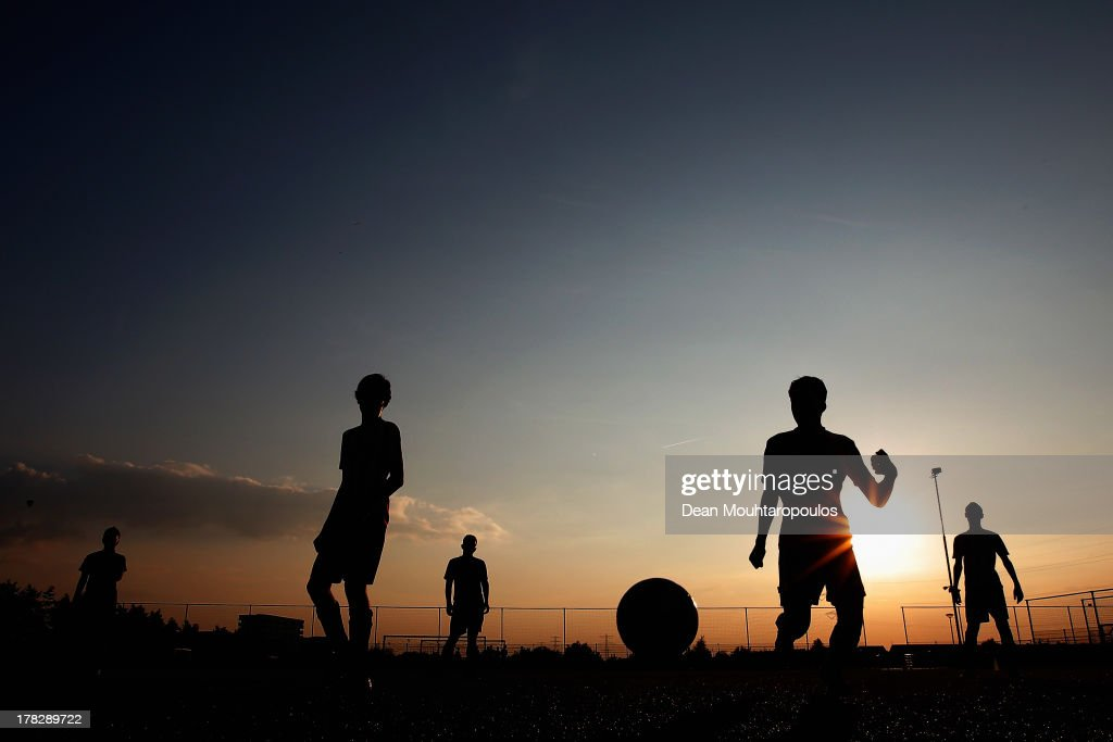 Youth Rosmalen players train on the near by grounds proir to the First round Dutch Cup match between OJC Rosmalen and HSV Hoekse Sportvereniging Hoek at Sportpark De Groote Wielen on August 28, 2013 in Rosmalen, Netherlands.