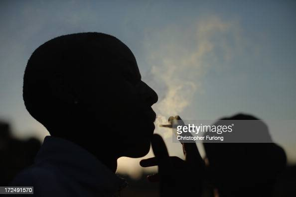 A youth smokes marijuana in Soweto township on July 2 2013 in Johannesburg South Africa Antiapartheid icon and Nobel Peace Prize laureate Nelson...