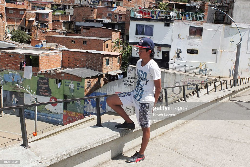 A youth stands in the designed urban spaces near Spain Library (Biblioteca Espana) which was constructed for the cultural and social transformation of the city built on the hill in the midst of slums on January 5, 2013 in Medellin, Colombia. The notorious slums of Medellin have gone through urban and educational projects to improve the quality of life for its residence.