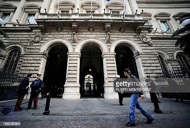 A youth walks past the Bank of Italy in Rome where a conference in honour of the late economist Tommaso PadoaSchioppa takes place on December 16 2011...