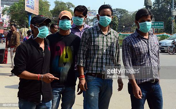 Youth wear mask while walking on road to prevent from Swine flu as there are many suspected patients infected found