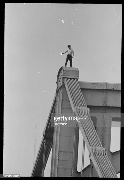 A youth whom police identified as Robert Michniak of Pittsburgh and formerly of Bethesda Ohio stands atop the 7th St Bridge and fires down at people...