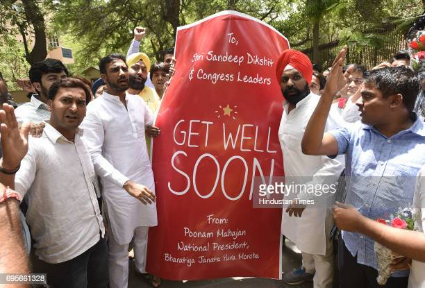 Youth Wing activists protest march to present 'Get Well Soon' Cards and flowers to Congress leader Sandeep Dikshit ExMP for his derogatory remarks...