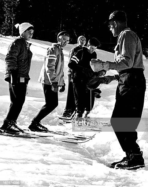 SCHOOL Youthful ski jumping aspirants get some expert advice from Harold 'Pop' Sorensen a leading instructor in the spectacular sport Sorensen is one...