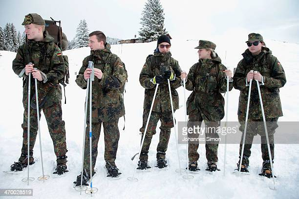 Youths await the start for hiking in the Bavarian Alps with members of the Gebirgsjaeger the alpine combat units of the German armed forces the...