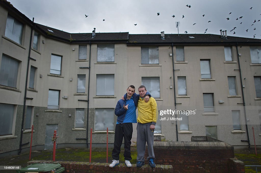 Youths congregate near disused housing in the Possil area on October 23, 2012 in Glasgow, Scotland. The Scottish National Party (SNP) have announced a welfare fund to provide emergency support to disadvantaged people who are struggling with issues such as unemployment, low income, poor health and lack of educational qualifications.