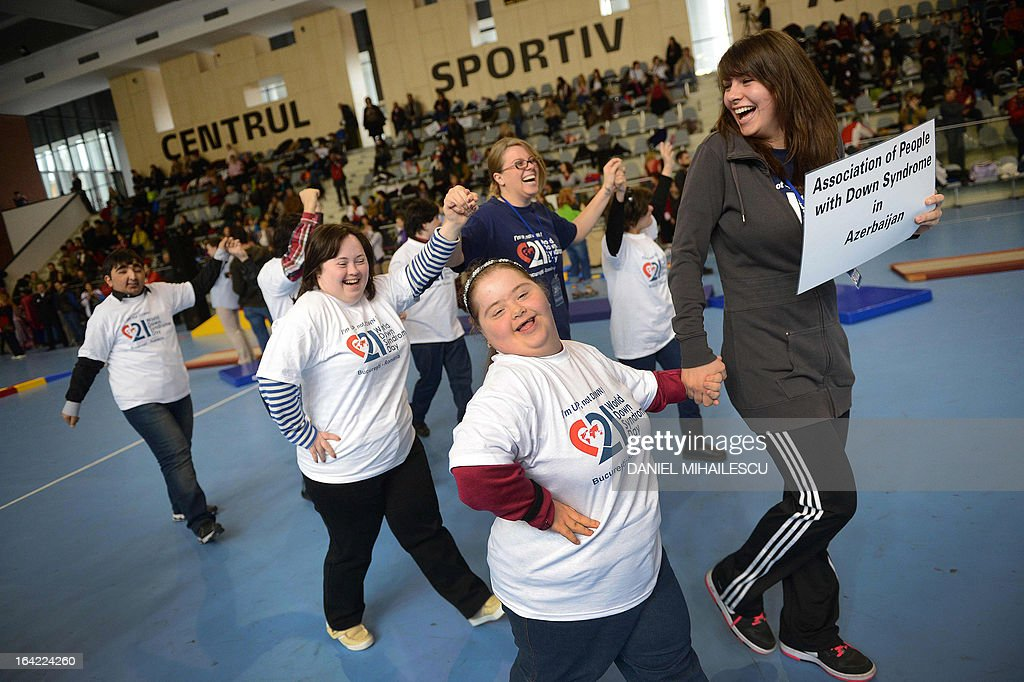 Youths from Azerbaidjan with Down Syndrome celebrate during an event marking the International Day of Down Syndrome in Bucharest March 21, 2013. March 21 aims to raise awareness among the population regarding people with Down syndrome and combat some wrong social perceptions, depriving these people of their right to an active life.