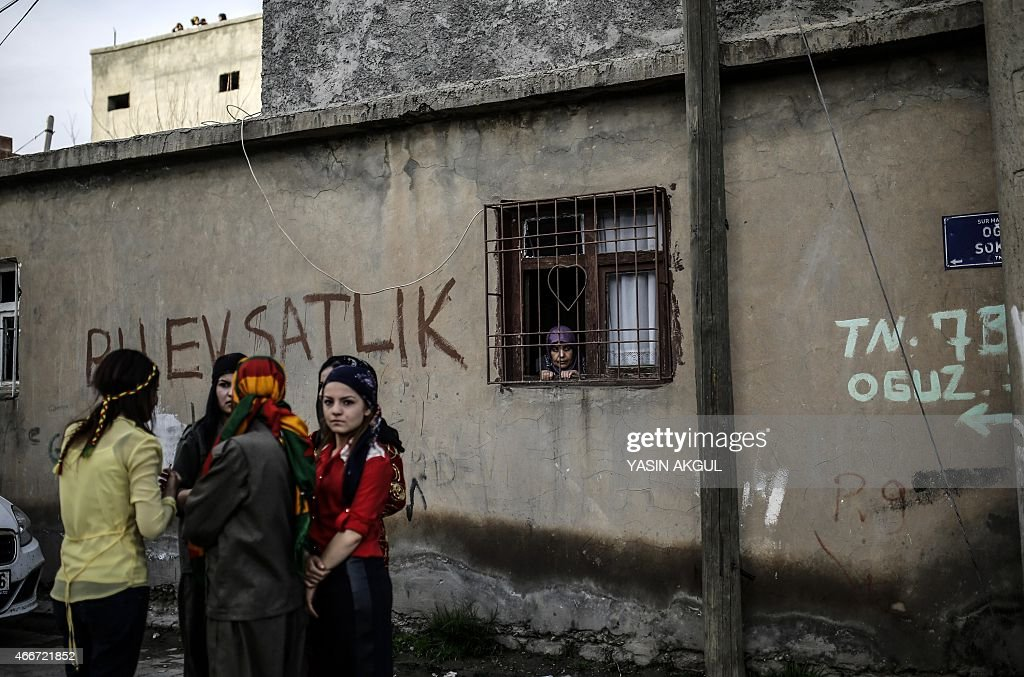 Youths from the Kurdish community gather in a street for celebrations surrounding Newroz which marks the arrival of spring and the new year in Cizre...