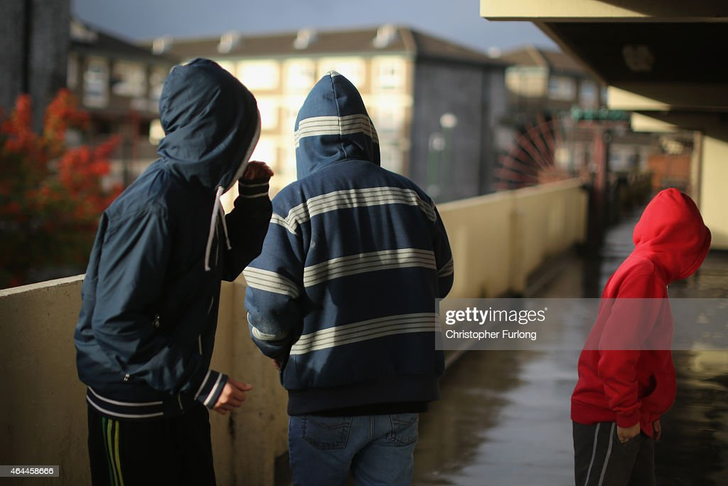 Youths loiter on a landing of the Falinge Estate which has been surveyed as one the most deprived areas in England for five years in a row on October...