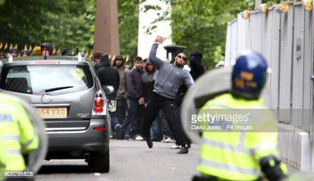 Youths pelt police with bricks as they separate the protesters from the English Defence League as they hold a demonstration in Birmingham