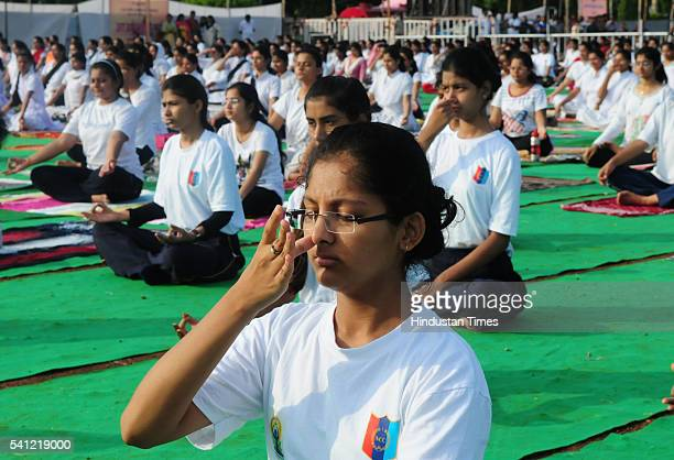 Youths performing yoga during the state level International Yoga Day programme at Lal Parade Ground on June 19 2016 in Bhopal India International...