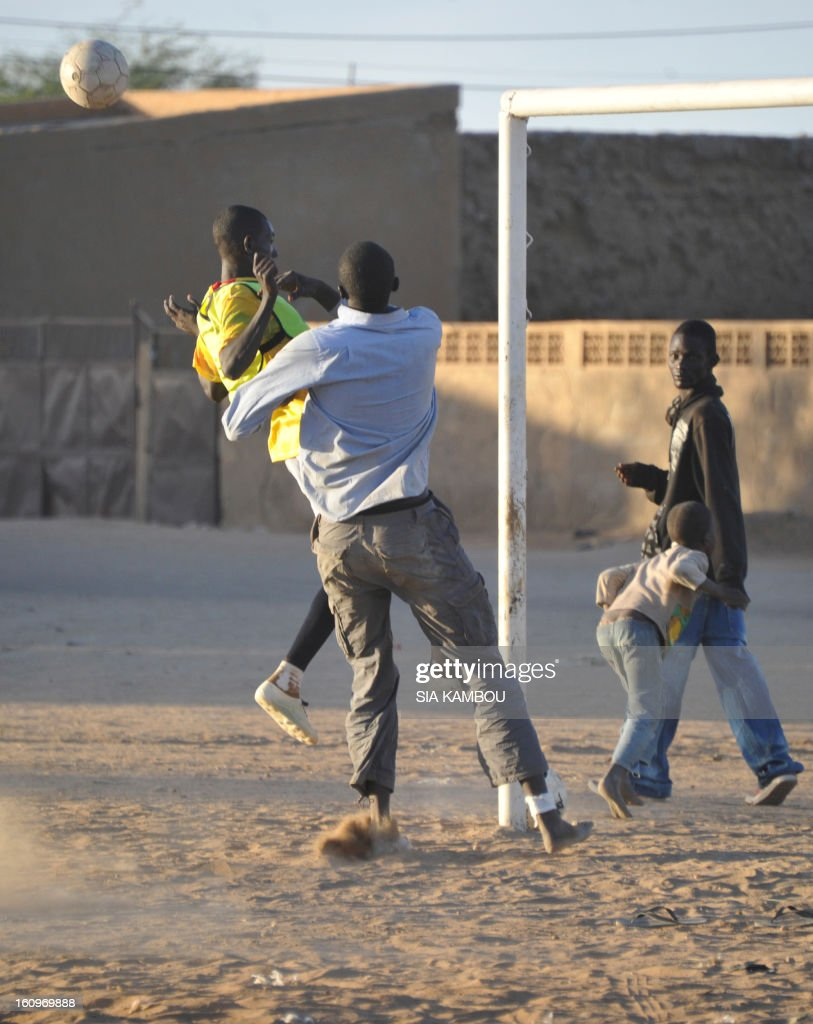 Youths play football on February 7, 2013 in the northern city of Gao. A suicide bomber blew himself up on February 8 near a group of Malian soldiers in Gao, where Islamist rebels driven from the town have resorted to guerilla attacks. The act marked the first suicide attack in the embattled west African nation since the start of a French-led offensive to oust the Islamists from Mali's north, where they had controlled key towns for 10 months.