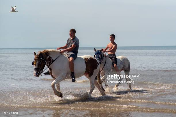 Youths ride their horses on Blackpool beach on June 19 2017 in Blackpool England The UK has officially been put on heatwave alert as the Government...