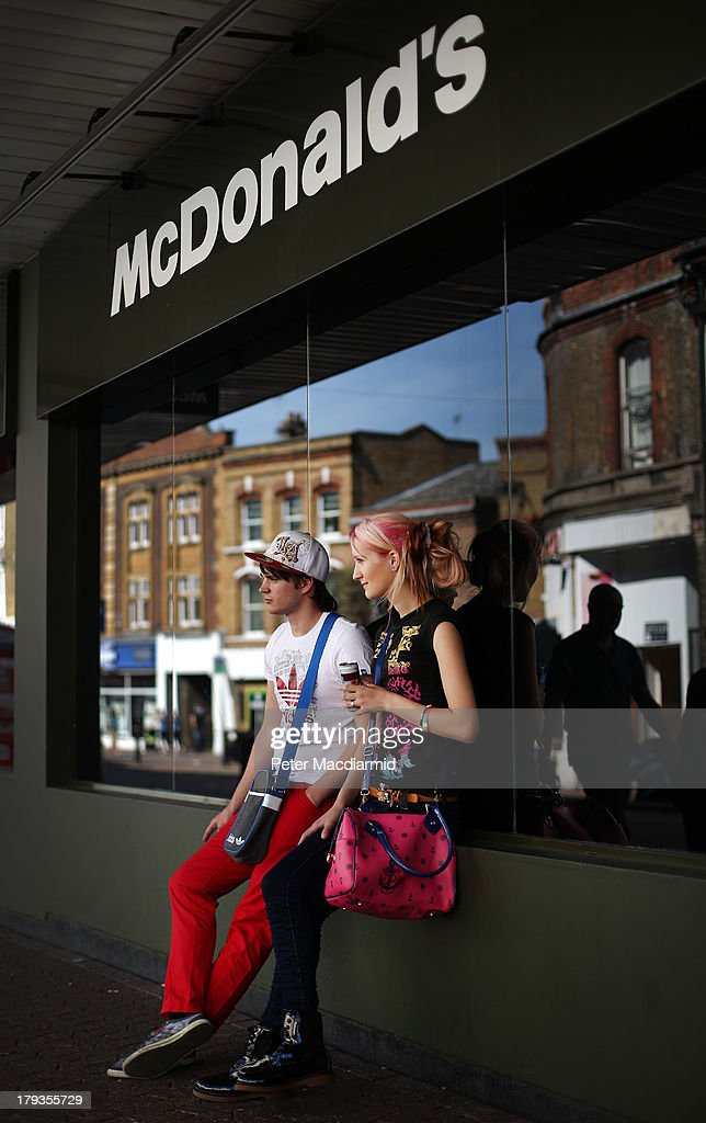 Youths sit outside a McDonald's in the High Street on September 2, 2013 in Dartford, England. High Street campaigner Mary Portas is today facing questions from Members of Parliament on the communities and local government select committee. The traditional high street is under increasing pressure due to the recession and the rise of on-line shopping.