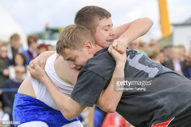 Youths taake part in the Cumberland Wrestling competition during the Westmorland County Show on September 14 2017 in Milnthorpe England The...