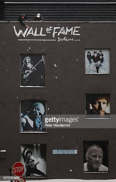 Youths throw snowballs from the roof of the Wall of Fame in Temple Bar on December 1 2010 in Dublin Ireland The Irish economy has faltered after...