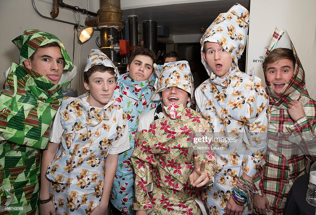 Youtube personalities Kian Lawley, Trevor Moran, Sam Pottorff, JC Caylen, Ricky Dillon and Connor Franta pose giftwrapped backstage before the O2L US Tour announcement at DigiFest LA at Hollywood Palladium on December 14, 2013 in Hollywood, California.