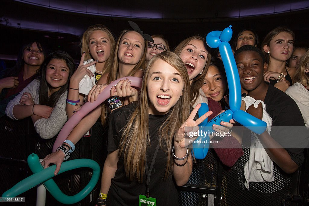 Youtube personality Jenn McAllister poses with fans at DigiFest LA at Hollywood Palladium on December 14, 2013 in Hollywood, California.