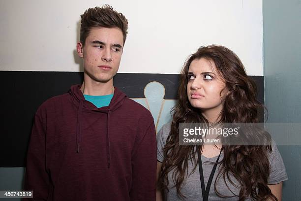 Youtube personality Kian Lawley of O2L and singer Rebecca Black pose backstage at DigiFest LA at Hollywood Palladium on December 14 2013 in Hollywood...