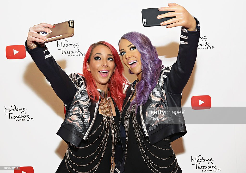 YouTube sensation Jenna Marbles (L) poses with a never-before-seen 'selfie experience' Madame Tussauds figure of herself during the unveiling at Madame Tussauds New York on October 26, 2015 in New York City.