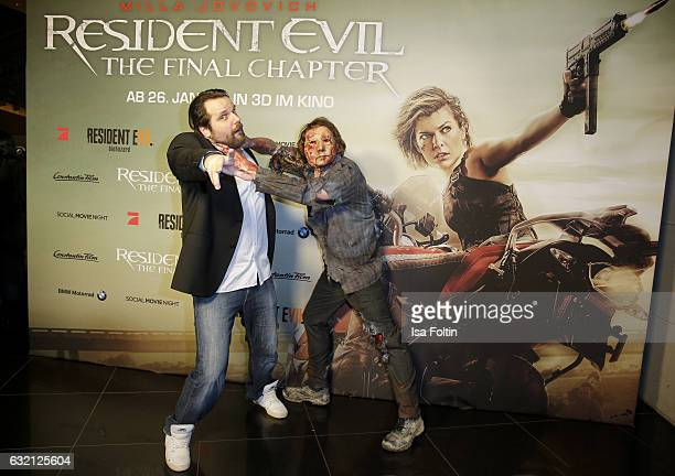 Youtube star and games producer Gronkh with a Zombie during Social Movie Night At 'Resident Evil The Final Chapter' premiere at CineStar on January...