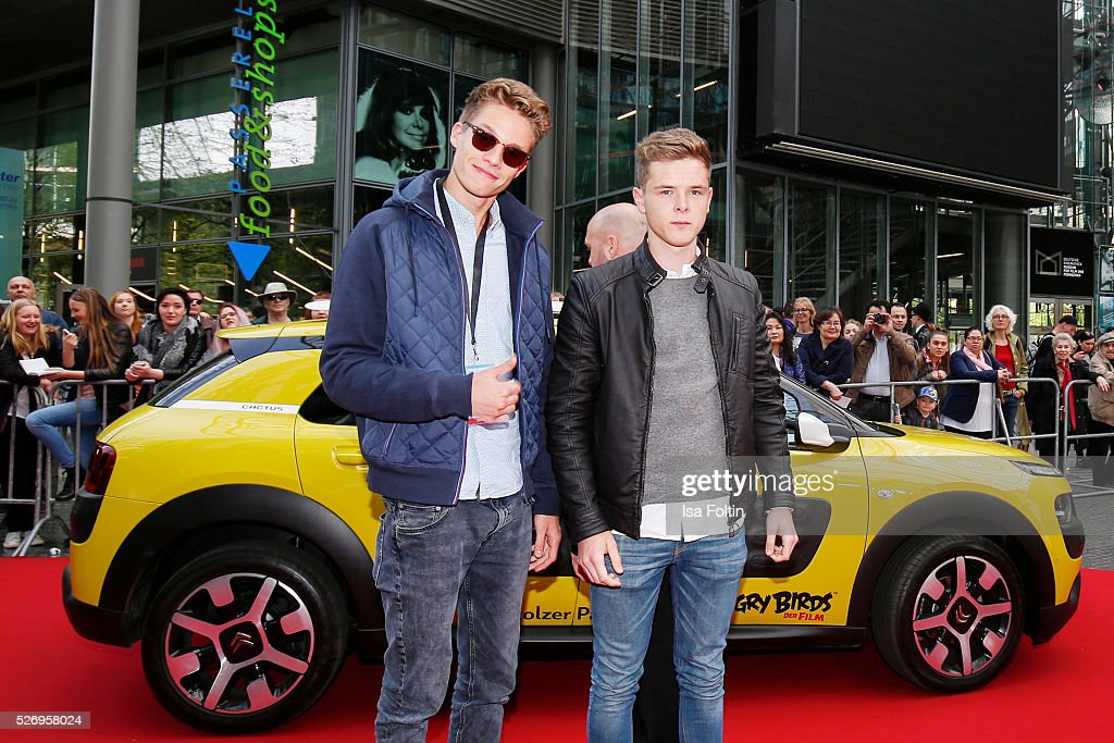 Youtube star Luca aka ConCrafter and a friend arrive at the red carpet at the Berlin premiere of the film 'Angry Birds - Der Film' at CineStar on May 1, 2016 in Berlin, Germany.