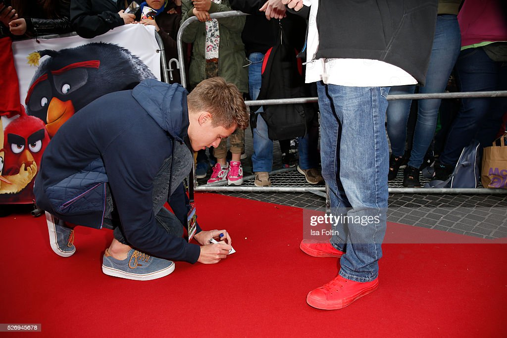 Youtube star Luca aka ConCrafter write autographs during the Berlin premiere of the film 'Angry Birds - Der Film' at CineStar on May 1, 2016 in Berlin, Germany.